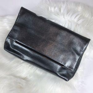 Halogen silver metallic fold over clutch purse.